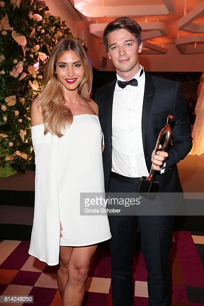 AnnKathrin Broemmel and Patrick Schwarzenegger with award during the PEOPLE Style Awards at Hotel Vier Jahreszeiten on March 7 2016 in Munich Germany