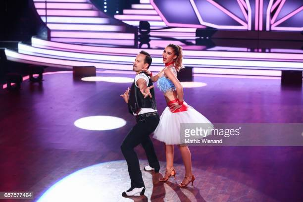 AnnKathrin Broemmel and Sergiu Luca perform on stage during the 2nd show of the tenth season of the television competition 'Let's Dance' on March 24...
