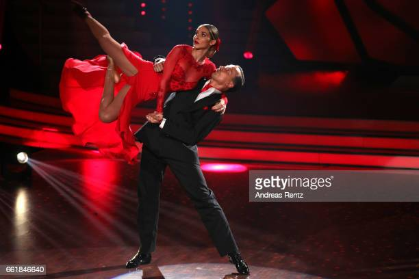 AnnKathrin Broemmel and Sergiu Luca perform on stage during the 3rd show of the tenth season of the television competition 'Let's Dance' on March 31...