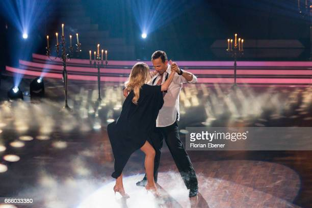 AnnKathrin Broemmel and Sergiu Luca perform on stage during the 4th show of the tenth season of the television competition 'Let's Dance' on April 7...
