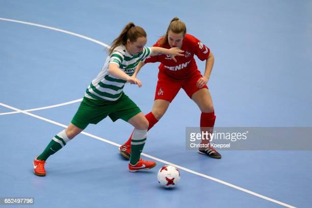 AnnKathrin Vinken of 1 FC Koeln challenges Emilie Stuetzle of SV Alberweiler during the B Junior Girl's German Futsal Championship at Bayer Hall on...