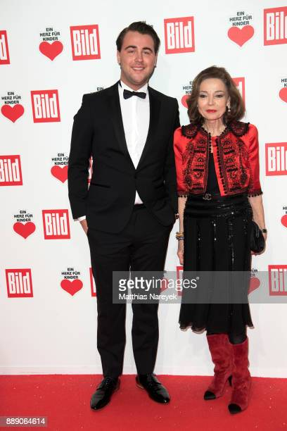AnnKatrin Bauknecht and a guest arrive the Ein Herz Fuer Kinder Gala at Studio Berlin Adlershof on December 9 2017 in Berlin Germany