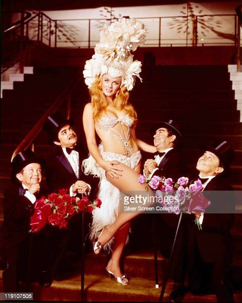 AnnMargret SwedishAmerican actress posing in costume along with five actor in top hats who gaze up at the actress in a publicity still issued for the...