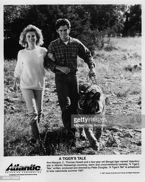 AnnMargret walks with C Thomas Howell and two year old Bengal tiger Valentino in a scene from the movie 'A Tiger's Tale' circa 1987