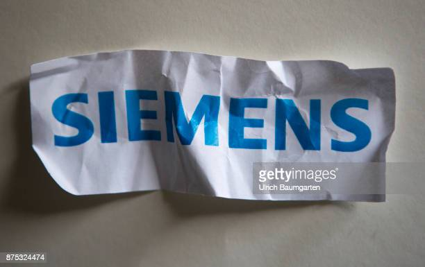Announced plant closures and job cuts turbulence at Siemens AG The photo shows a crumpled Siemens logo