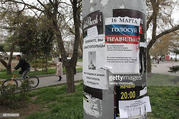 Announcements are seen on the pole on April 5 2014 in Sevastopol in the disputed Crimean Peninsula Many Ukrainian banks are already closed in Crimea...