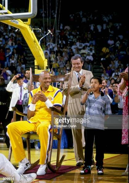 Announcer Chick Hearn and Kareem AbdulJabbar of the Los Angeles Lakers attend a ceremony for the retirement of Jabbar's jersey number at the Great...