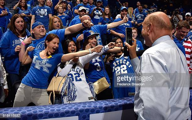 Announcer Dick Vitale takes a photo of actress Ashley Judd and other fans of the Kentucky Wildcats after an 8277 overtime Kentucky victory over the...