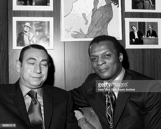 TV announcer Howard Cosell and baseball player Curt Flood sit backstage at WABCTV Studio 15 prior to their appearance on the Dick Cavett show on...