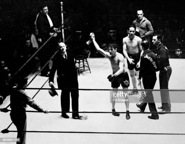 Announcer Joe Humphries raises the hand of the victor British boxer Jack 'Kid' Berg aka 'The Whitechapel Whirlwind' who beat American boxer Tony...