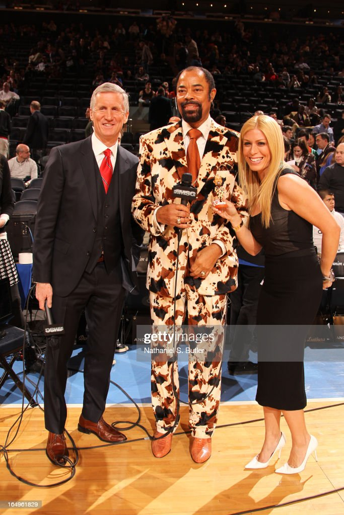 MSG announcer, Mike Breen and MSG reporter Jill Martin stand with Walter Clyde Frazier on his birthday with his commemorative bobblehead doll before the New York Knicks play the Charlotte Bobcats on March 29, 2013 at Madison Square Garden in New York City.