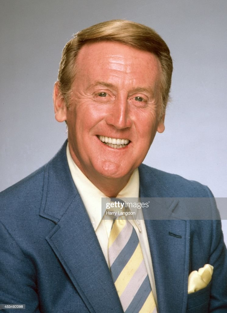 TV Announcer <a gi-track='captionPersonalityLinkClicked' href=/galleries/search?phrase=Vin+Scully&family=editorial&specificpeople=878517 ng-click='$event.stopPropagation()'>Vin Scully</a> poses for a portrait in 2002 in Los Angeles, California.