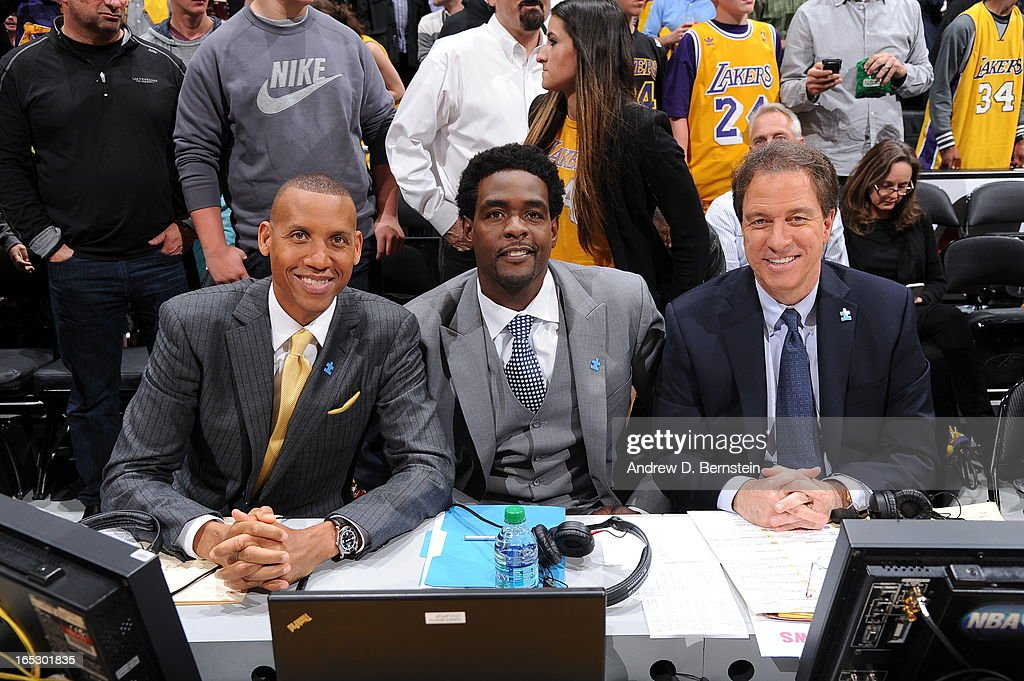 TNT announcers Reggie Miller, Chris Webber, and Kevin Harlan pose for a photograph at Staples Center on April 2, 2013 in Los Angeles, California. The announcers are wearing blue lapel pins in honor of Autism Awareness.
