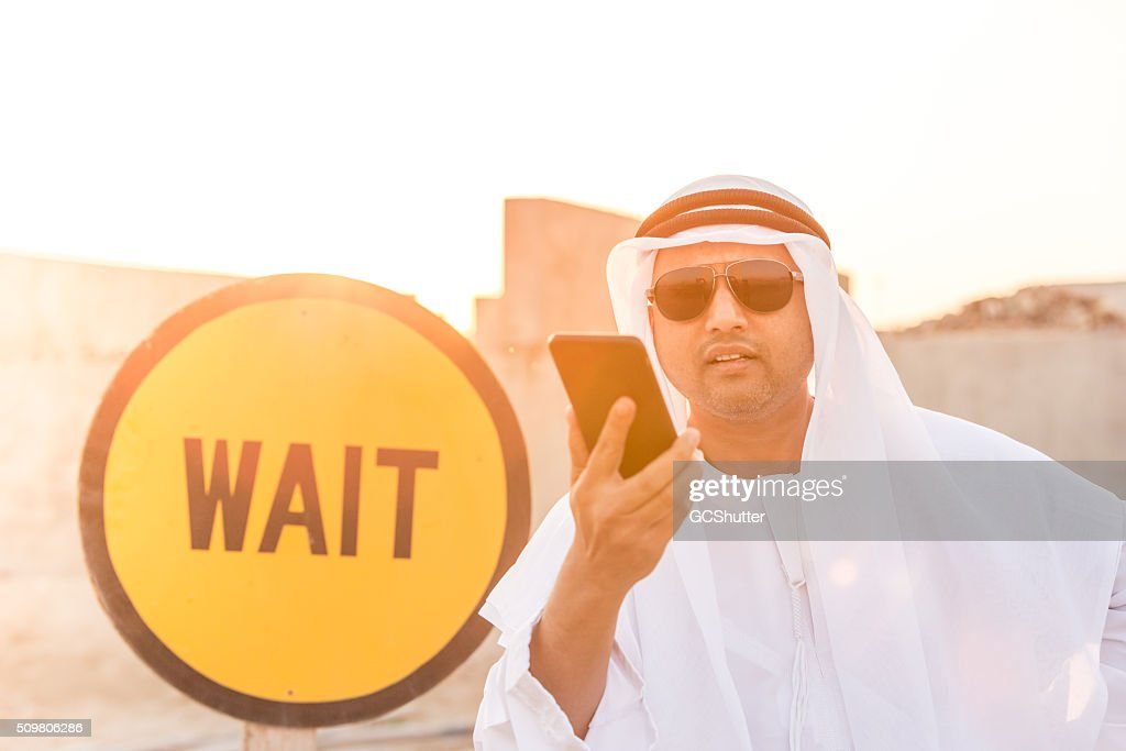 Annoyed Arab Near the Wait Sign at a Construction Site