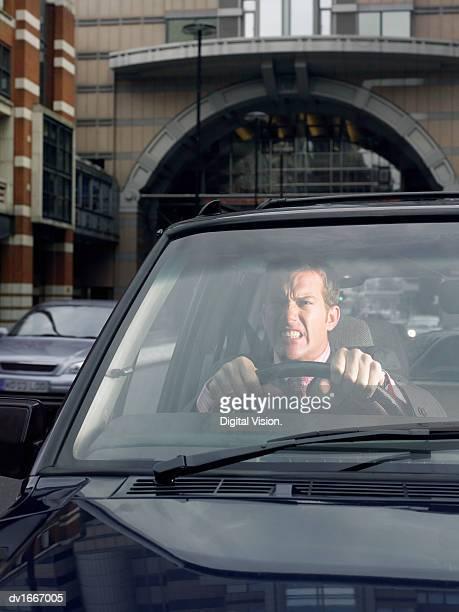 Annoyed Man Driving a Car
