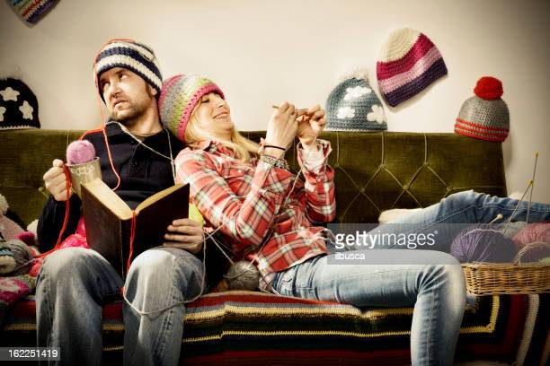 Annoying young knitter woman couple portrait on couch