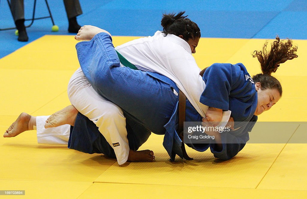 Anny Caroline Avelino Ribeiro of Brazil (white) competes against Mackenzie Williams of the USA in the cadet womens +63 kg division of the Judo event in the Sports Halls during day four of the Australian Youth Olympic Festival at Sydney Olympic Park Sports Centre on January 19, 2013 in Sydney, Australia.