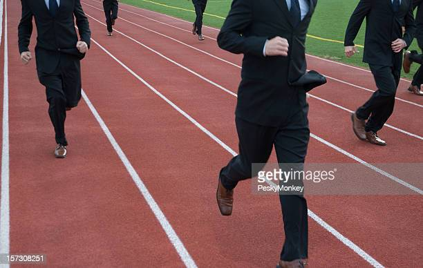 Anonymous Businessmen Run a Race on Running Track