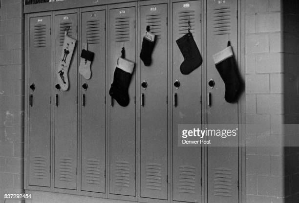 Anonymous Gifts And Christmas Stockings Hang On Hall Lockers Gifts such items as a piece of candy an ornament a cookie a bright coin a new pencil a...