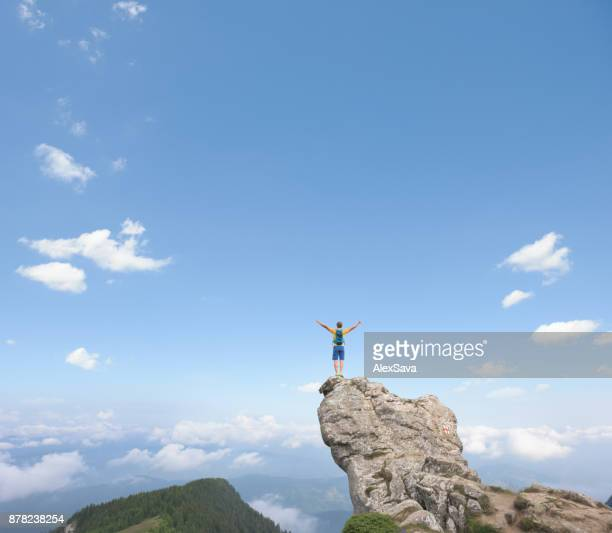 Anonymous man on top of the mountain