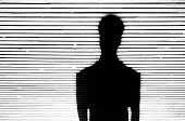 Anonymous person portrait silhouette in black and white on patterned background