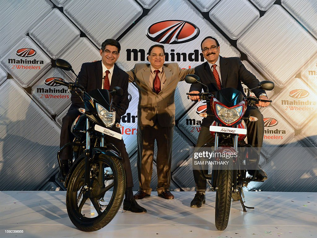 Anoop Mathur (C), President of Two Wheeler Sector and Member of the Group Executive Board Mahindra and Mahindra, Company's Executive Vice-President Viren Popli (L) and Company's Senior Vice President, Sales and Customer Care, Dharmendra Mishra (R) pose with Mahindra and Mahindra bikes during their launch in Ahmedabad on January 10, 2012. AFP PHOTO / Sam PANTHAKY