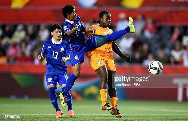 Anootsara Maijaren of Thailand challenges Christine Lohoues of Cote D'Ivoire during the FIFA Women's World Cup 2015 Group B match between Cote...