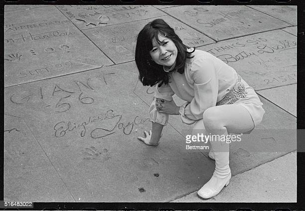 Another dark haired beauty made her imprint where Tsai Chin playfully pretends among the hand and footprints of Hollywood greats The five foot two...
