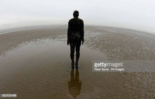 Another Place by Angel of the North creator Antony Gormley on Crosby Beach Merseyside that has been granted a stay of execution