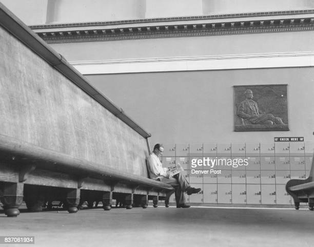 Another unusual sight is this view of a lone traveler sitting in almost empty waiting room at Denver's union station He is Charles A Neer awaiting a...