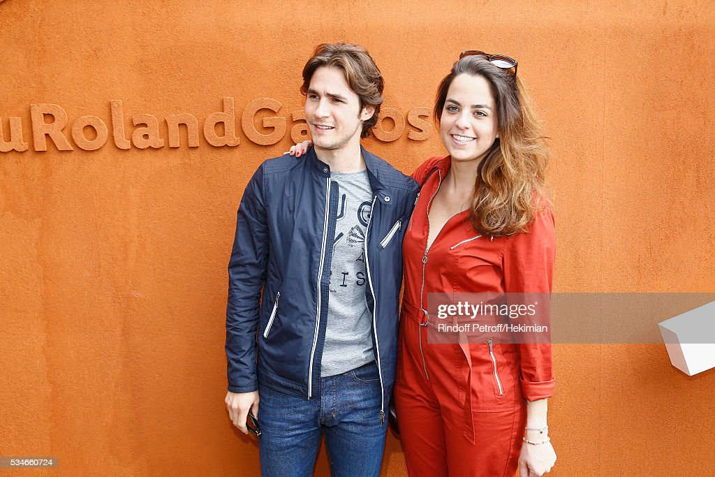 <a gi-track='captionPersonalityLinkClicked' href=/galleries/search?phrase=Anouchka+Delon&family=editorial&specificpeople=4383779 ng-click='$event.stopPropagation()'>Anouchka Delon</a> and her boyfriend Julien Dereins attend the French Tennis Open Day 6 at Roland Garros on May 27, 2016 in Paris, France.