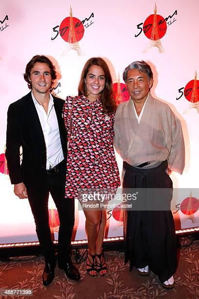 Anouchka Delon standing between her companon Julien Dereins and Kenzo Takada attend the Kenzo Takada's 50 Years Of Life in Paris Celebration at...