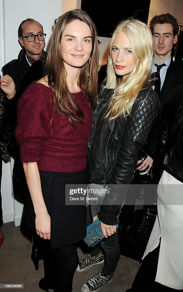Anouck Lepere (L) and Poppy Delevingne attend a private viewing of 'Gaucho', a photographic exhibition by Astrid Munoz, at the Jaeger-LeCoultre Boutique on January 31, 2012 in London, England.