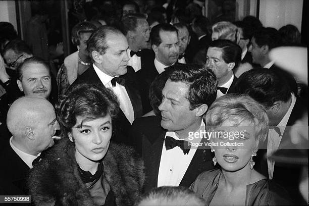 Anouk Aimee Marcello Mastroianni and Magali Noeel about 1960