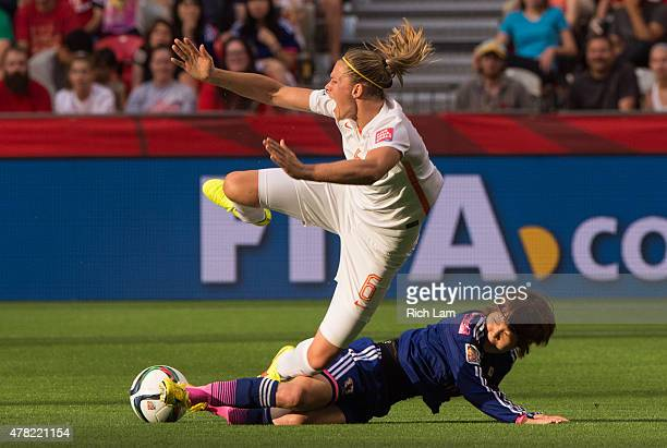 Anouk Dekker of the Netherlands reacts while falling after getting tackled by Mizuho Sakaguchi of Japan during the FIFA Women's World Cup Canada 2015...