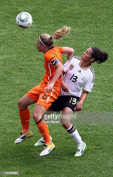 Anouk Hoogendijk of Netherlands is challenged by Celia Okoyino da Mbabi of Germany during the Women's International friendly match between Germany...