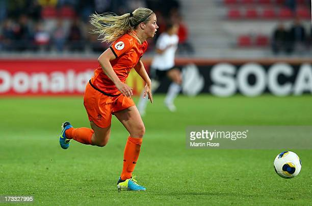 Anouk Hoogendijk of Netherlands runs with the ball during the UEFA Women's Euro 2013 group B match at Vaxjo Arena on July 11 2013 in Vaxjo Sweden