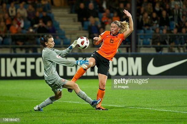 Anouk Hoogendijk of the Netherlands tackles Milena Vukovic of Serbia during the UEFA Women's EURO 2013 qualifying match between the Netherlands and...