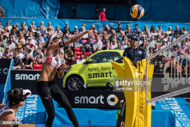 Anouk VergeDepre of Switzerland spikes the ball during the match against Laura Ludwig and Kira Walkenhorst of Germany during Day 3 of the Swatch...