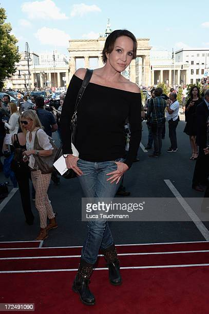 Anouschka Renzi attends Riani Show during MercedesBenz Fashion Week Spring/Summer 2014 at Brandenburg Gate on July 2 2013 in Berlin Germany
