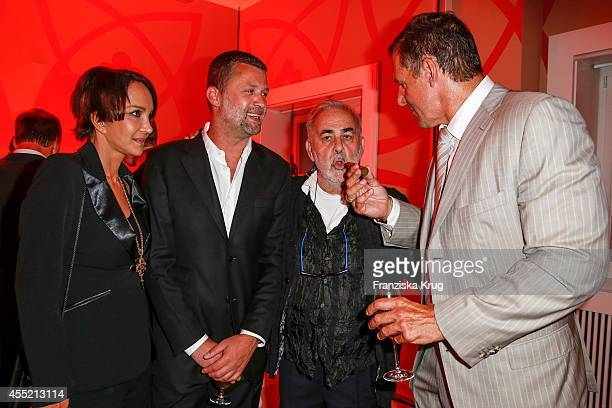 Anouschka Renzi Carsten ThammWalz Udo Walz and Ralf Moeller attend the Bertelsmann Summer Party at the Bertelsmann representative office on September...
