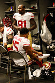 Anquan Boldin and Michael Crabtree of the San Francisco 49ers get ready in the locker room prior to the game against the Oakland Raiders at Oco...