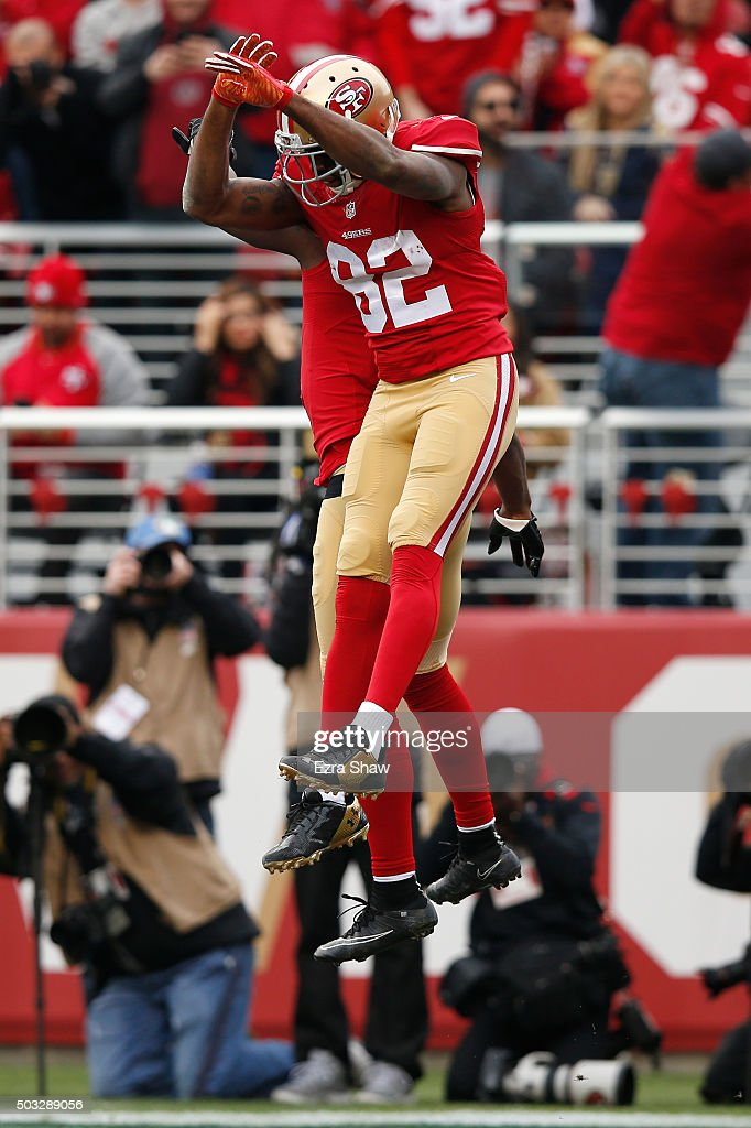 Anquan Boldin and Torrey Smith of the San Francisco 49ers celebrate after a 33yard touchdown catch by Boldin against the St Louis Rams during their...
