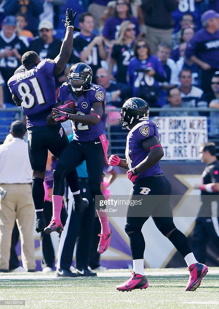 <a gi-track='captionPersonalityLinkClicked' href=/galleries/search?phrase=Anquan+Boldin&family=editorial&specificpeople=182484 ng-click='$event.stopPropagation()'>Anquan Boldin</a> #81 celebrates with <a gi-track='captionPersonalityLinkClicked' href=/galleries/search?phrase=Jacoby+Jones&family=editorial&specificpeople=4167942 ng-click='$event.stopPropagation()'>Jacoby Jones</a> #12 of the Baltimore Ravens after Jones returned a kickoff for a touchdown against the Dallas Cowboys during the second half at M&T Bank Stadium on October 14, 2012 in Baltimore, Maryland.