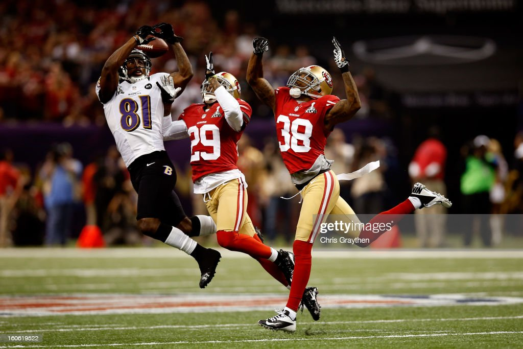 Anquan Boldin #81 of the Baltimore Ravens attempts to catch a pass in front of Chris Culliver #29 and Dashon Goldson #38 of the San Francisco 49ers in the second half during Super Bowl XLVII at the Mercedes-Benz Superdome on February 3, 2013 in New Orleans, Louisiana.