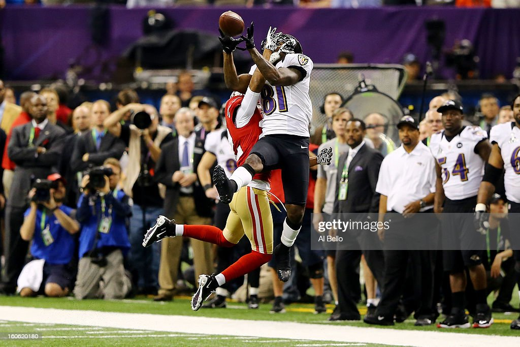 Anquan Boldin #81 of the Baltimore Ravens catches a thrid down pass over Carlos Rogers #22 of the San Francisco 49ers at the 7:10 mark in the fourth quarter during Super Bowl XLVII at the Mercedes-Benz Superdome on February 3, 2013 in New Orleans, Louisiana. The Ravens won 34-31.