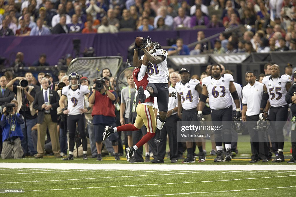 <a gi-track='captionPersonalityLinkClicked' href=/galleries/search?phrase=Anquan+Boldin&family=editorial&specificpeople=182484 ng-click='$event.stopPropagation()'>Anquan Boldin</a> #81 of the Baltimore Ravens catches a thrid down pass over <a gi-track='captionPersonalityLinkClicked' href=/galleries/search?phrase=Carlos+Rogers+-+American+Football+Player&family=editorial&specificpeople=9738833 ng-click='$event.stopPropagation()'>Carlos Rogers</a> #22 of the San Francisco 49ers at the 7:10 mark in the fourth quarter during Super Bowl XLVII at the Mercedes-Benz Superdome on February 3, 2013 in New Orleans, Louisiana. The Ravens won 34-31.