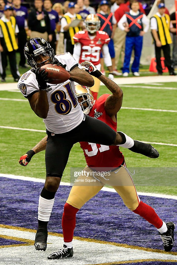 Anquan Boldin #81 of the Baltimore Ravens catches a touchdown pass in the first quarter over Donte Whitner #31 of the San Francisco 49ers during Super Bowl XLVII at the Mercedes-Benz Superdome on February 3, 2013 in New Orleans, Louisiana.