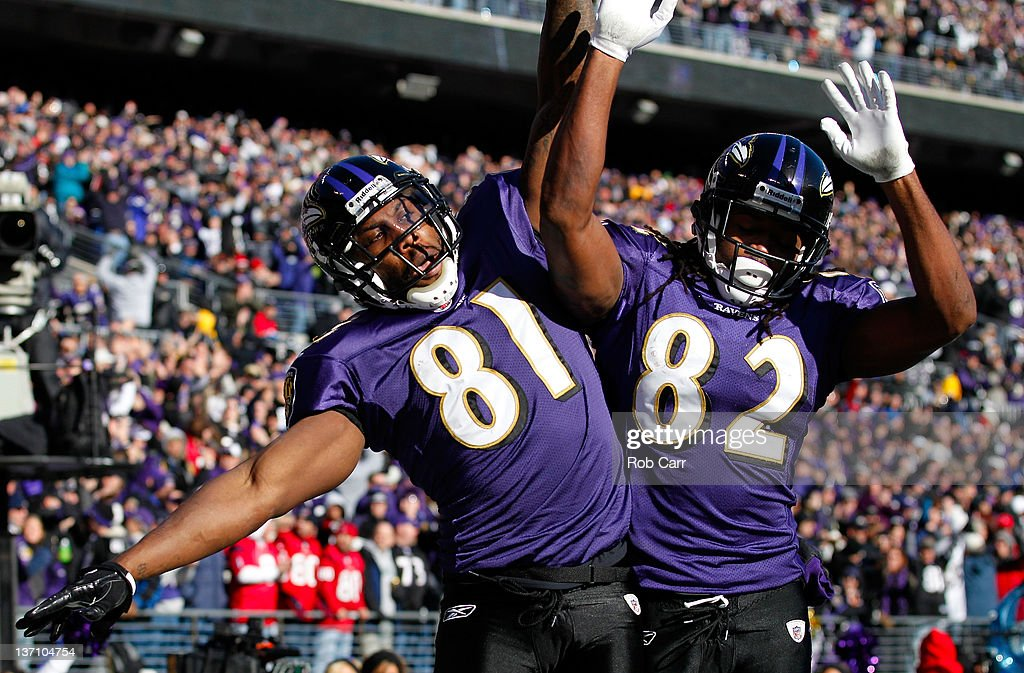 <a gi-track='captionPersonalityLinkClicked' href=/galleries/search?phrase=Anquan+Boldin&family=editorial&specificpeople=182484 ng-click='$event.stopPropagation()'>Anquan Boldin</a> #81 of the Baltimore Ravens celebrates scoring a touchdown with teammate Torrey Smith #82 against the Houston Texans during the first quarter of the AFC Divisional playoff game at M&T Bank Stadium on January 15, 2012 in Baltimore, Maryland.