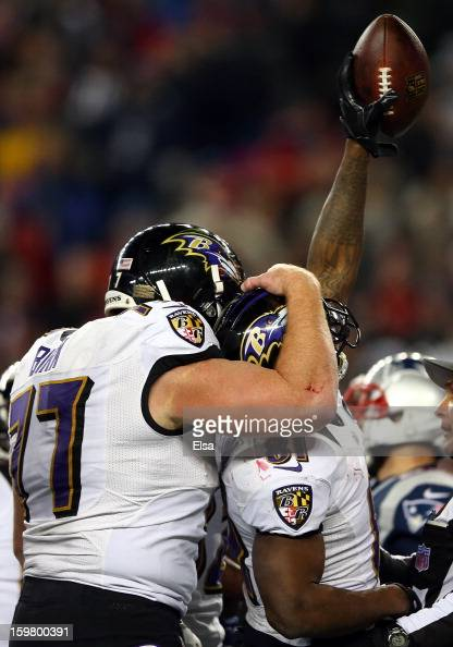 Anquan Boldin of the Baltimore Ravens celebrates with teammate Matt Birk after scoring a touchdown passed by Joe Flacco in the fourth quarter against...